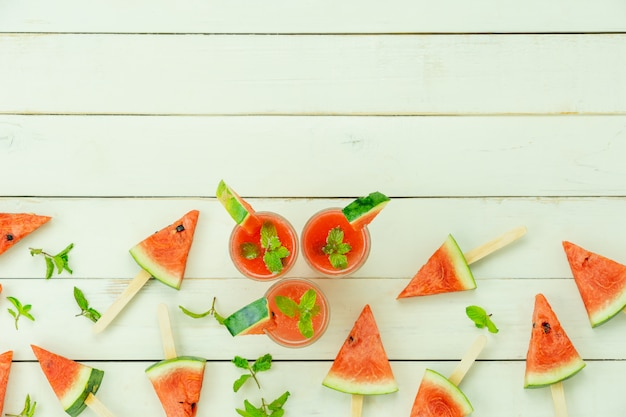 Table top view fruit tropical with drink with spring summer holiday and vacation background concept Premium Photo