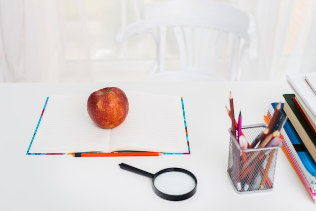 Table with copybook and pencils Free Photo