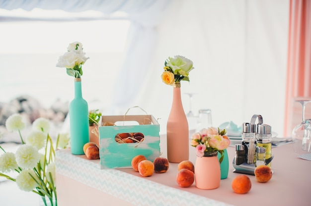 Table with decorative bottles and fruit Premium Photo