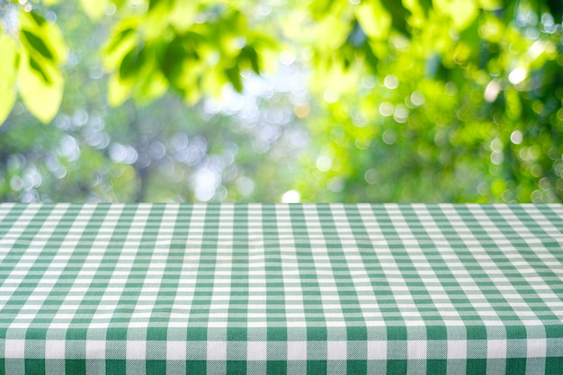 table with green tablecloth over bokeh background for food and