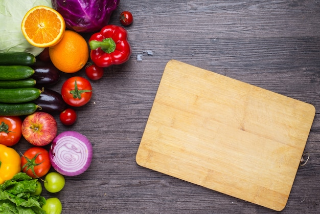 Beautiful Table With Vegetables And A Cutting Board Free Photo