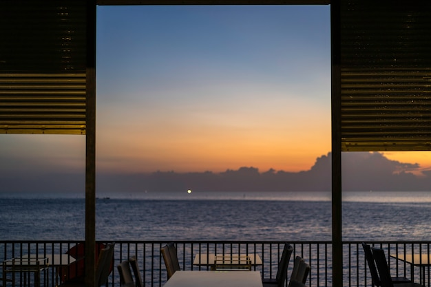 Tables and chairs in restaurant near the sea Premium Photo