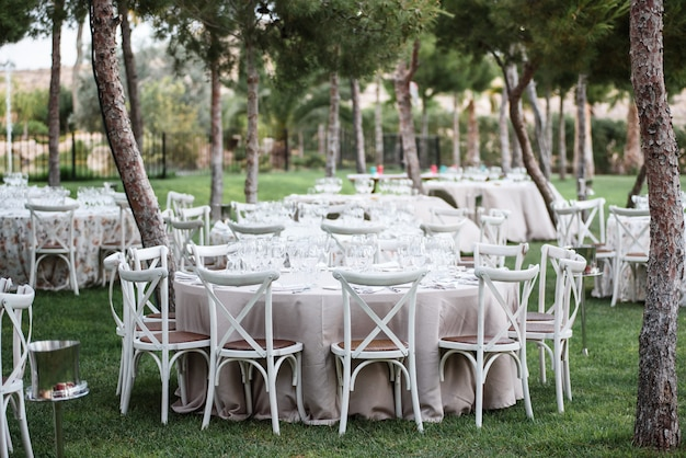 Tables decor in the restaurant on wedding day. paster decorations, outdoor Premium Photo