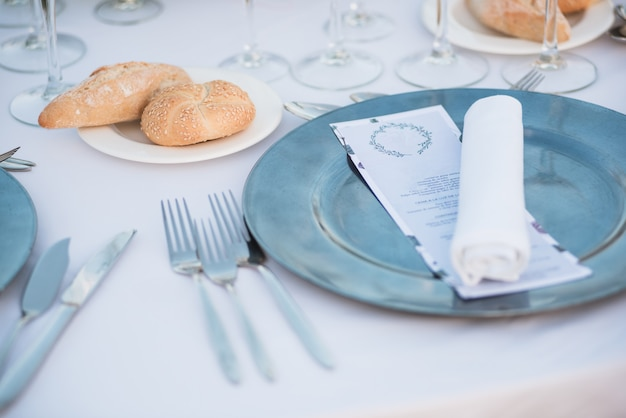 Tables set for an event party or wedding reception. Premium Photo