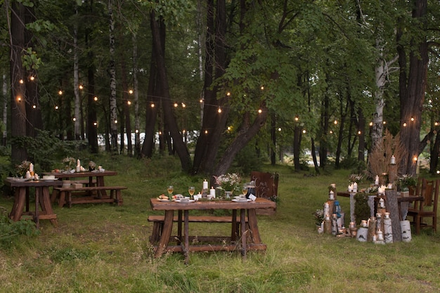 Tables set in forest Premium Photo