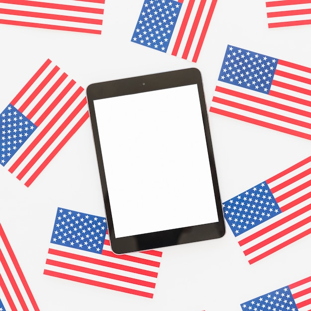 Tablet and little national us flags Free Photo
