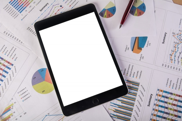Tablet with blank screen over business chart. Copy space. Business concept.v Free Photo