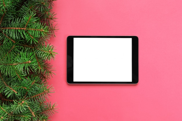 Tablet with blank screen on the pink pastel Premium Photo