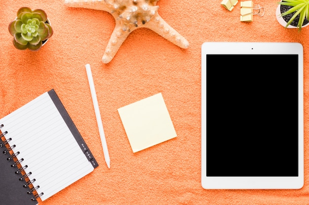 Tablet with office tools on light background Free Photo
