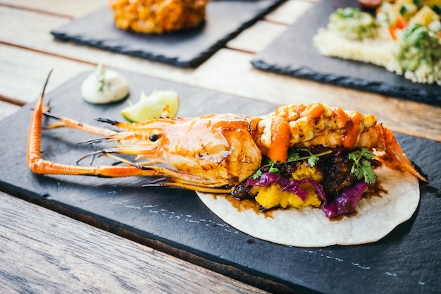 Taco with prawn or shrimp and sauce Free Photo