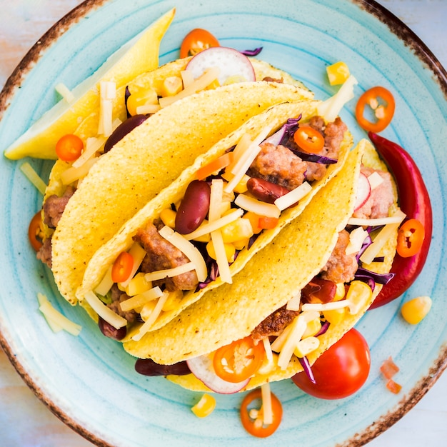 Tacos with meat filler on plate Free Photo