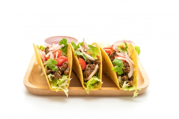 Tacos with meat and vegetables isolated on white background Premium Photo