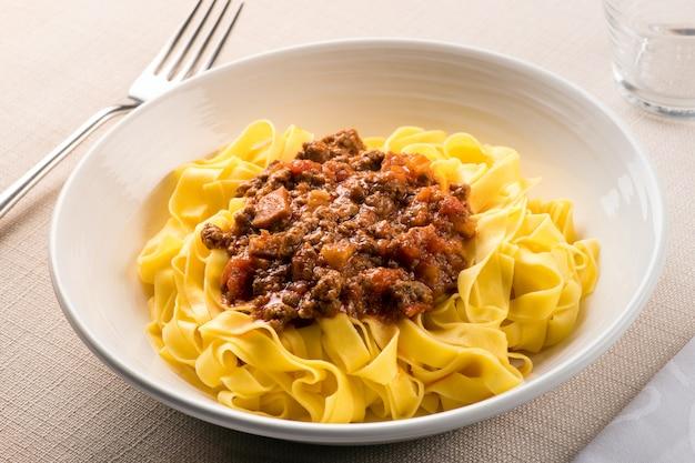 Taglietelle al ragu, from emilia romagna, italy Premium Photo