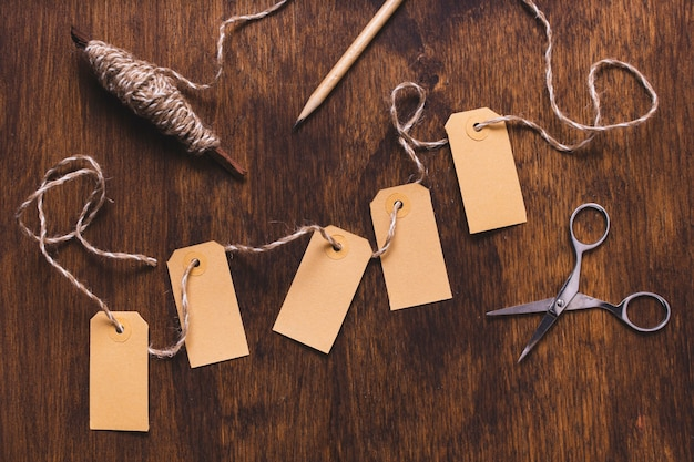 Tags with string and scissors Free Photo