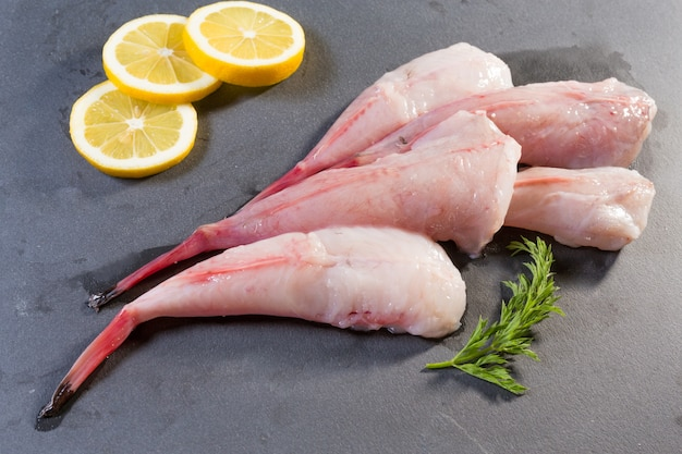 Tails of monkfish presented on a slate Premium Photo