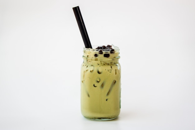 Taiwan iced milk green tea in glass jar on white background Premium Photo
