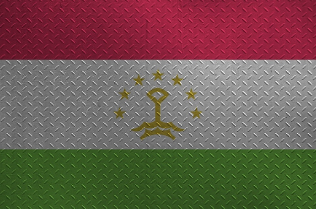 Tajikistan flag depicted in paint colors on old brushed metal plate or wall closeup. textured banner on rough background Premium Photo