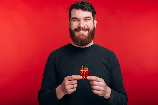 small gift smiling bearded man
