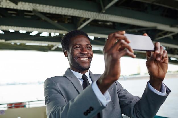Taking selfie on smartphone Free Photo