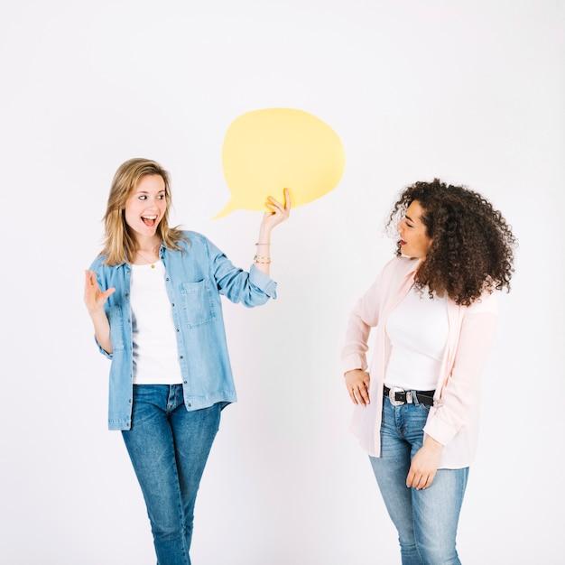 Talking women with speech balloon Free Photo