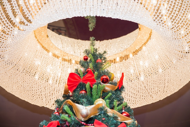 Tall christmas tree with luster Premium Photo