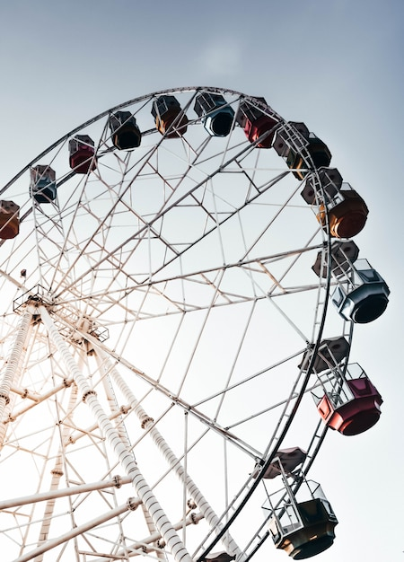 Tall ferris wheel with the beautiful clear sky Free Photo