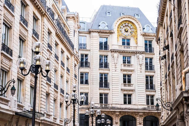 Tall french building with a big clock Premium Photo