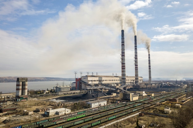 Tall pipes of power plant with smoke Premium Photo