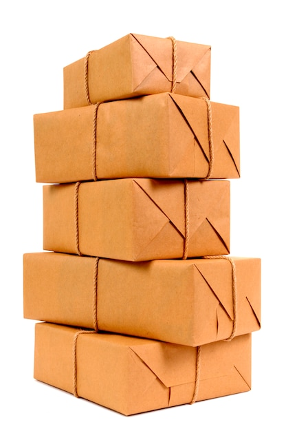 Tall stack of brown paper packages Free Photo