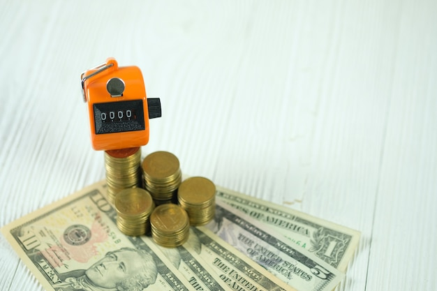 Tally counter or counting machine on coin and banknote Premium Photo