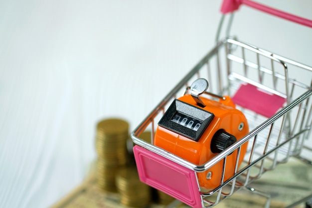Tally counter or counting machine and shopping cart trolley Premium Photo