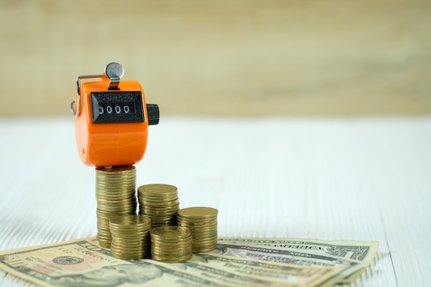 Tally counter or counting machine with coin and money Premium Photo