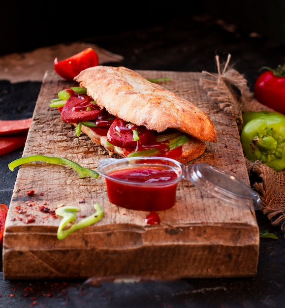 Tandir bread doner, sucuk ekmek with sausage on a wooden board Free Photo