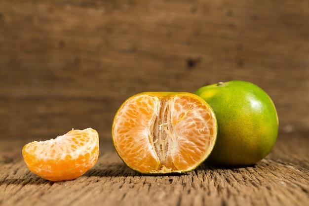 Tangerine. sweet orange. on wooden. texture wooden Premium Photo