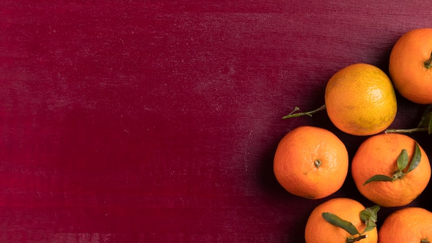 Tangerines for chinese new year with red background Free Photo