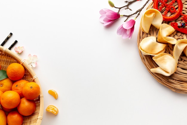 Tangerines and fortune cookies chinese new year Free Photo