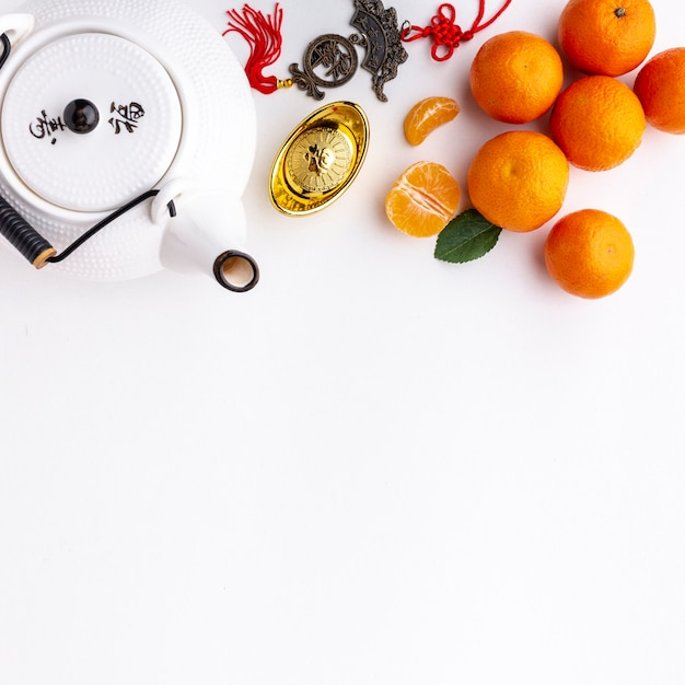 Tangerines and teapot chinese new year Free Photo