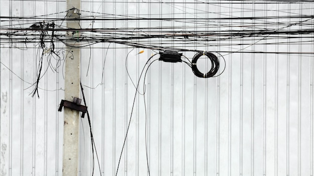 Tangle electric line on pole at the street in the city Premium Photo