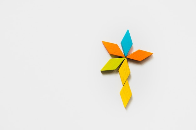 Tangram puzzle flower shape use for education and creative concept Premium Photo