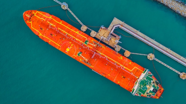 Tanker ship loading in port view from above, tanker ship logistic import export business Premium Photo