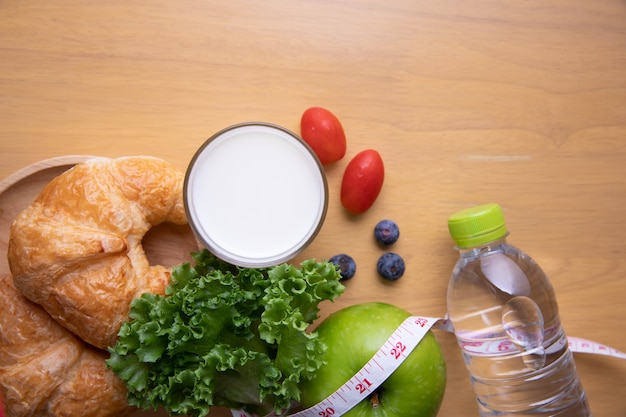Tape measure and diet food Free Photo