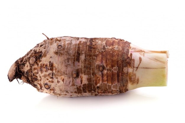 Taro root isolated on a white background. Premium Photo