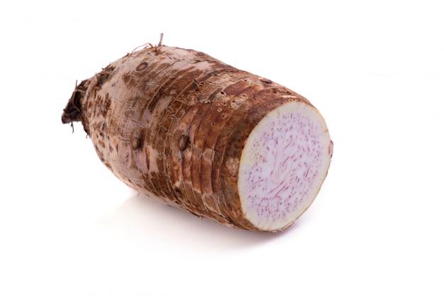 Taro root isolated on a white background. Premium Photo