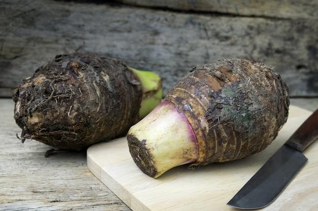 Taro on wooden Premium Photo