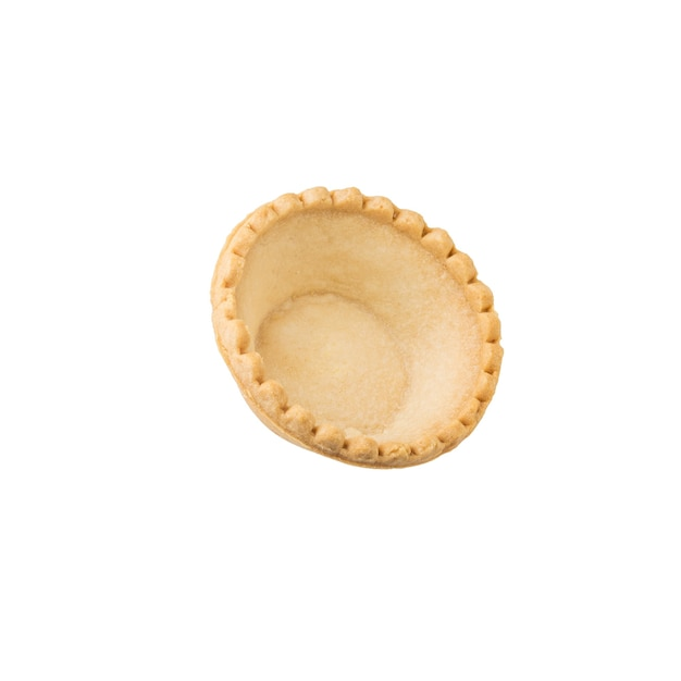 Tartlet for snacks isolated on a white surface. baked goods for snacks. Premium Photo