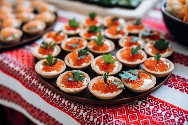 Tartlets with red caviar closeup, gourmet food Free Photo