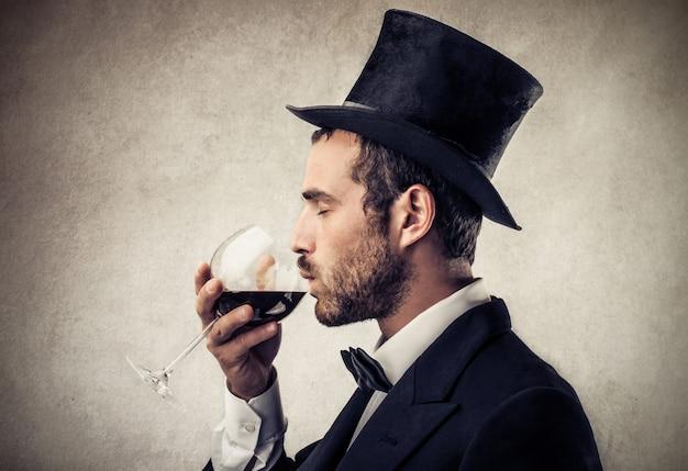 Tasting wine elegantly Premium Photo