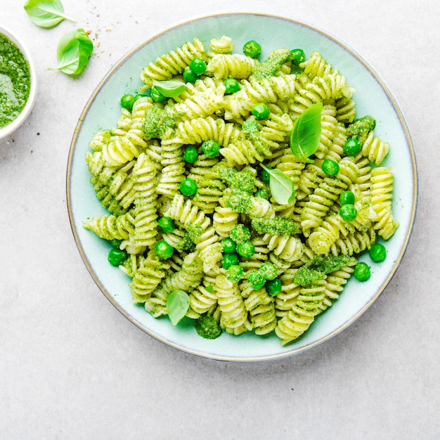 Tasty appetizing pasta with pesto on plate Free Photo