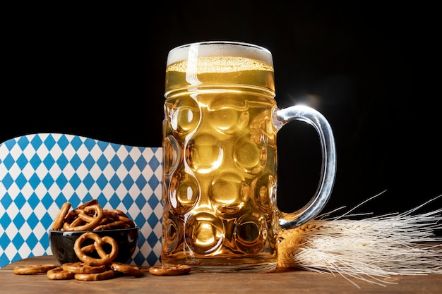 Tasty bavarian beer on a table with pretzels Free Photo
