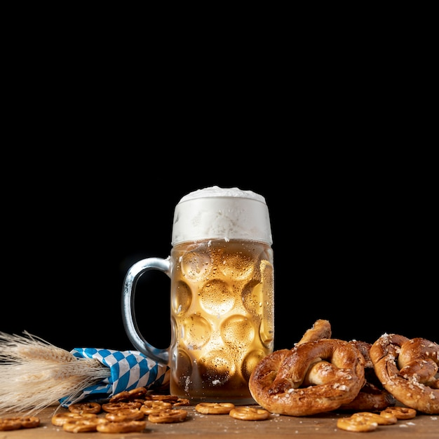 Tasty bavarian beer with pretzels on a table Free Photo